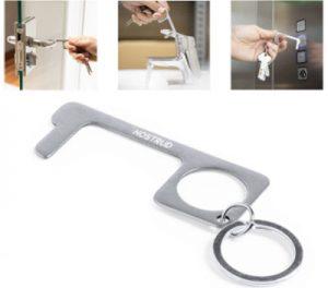 Llavero abre-puertas metálico para evitar contacto y prevenir contagios.